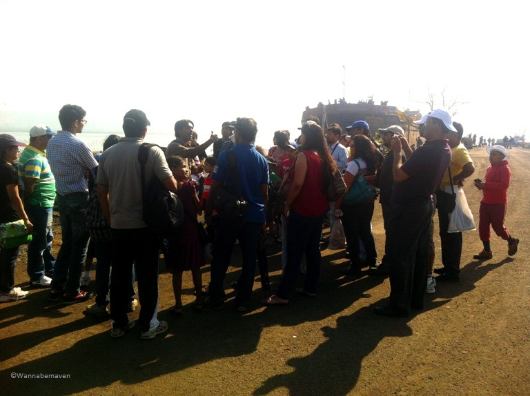 Sewri Jetty Flamingos - A guide and a group of visitors who came to view flamingo's